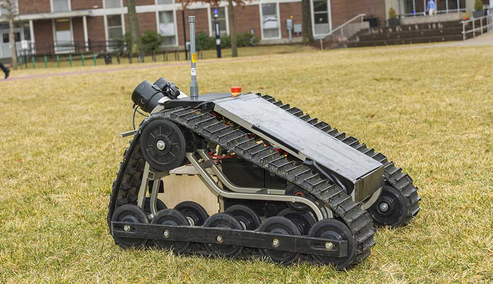 A photo of an autonomous security robot designed by students on the Quad.