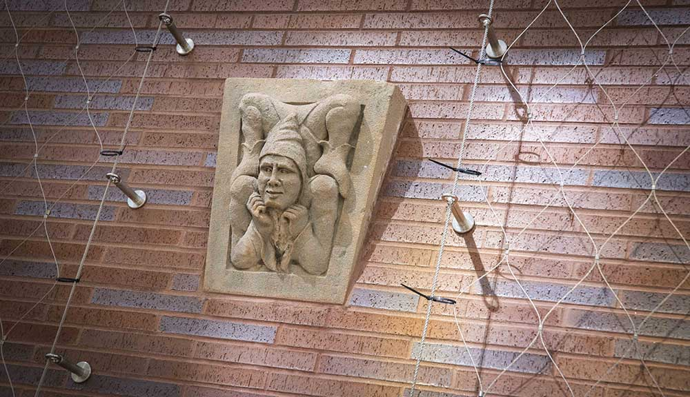 A close-up photo of one of the grotesques along the walkway between Harrington Auditorium and the Foisie Innovation Studio.