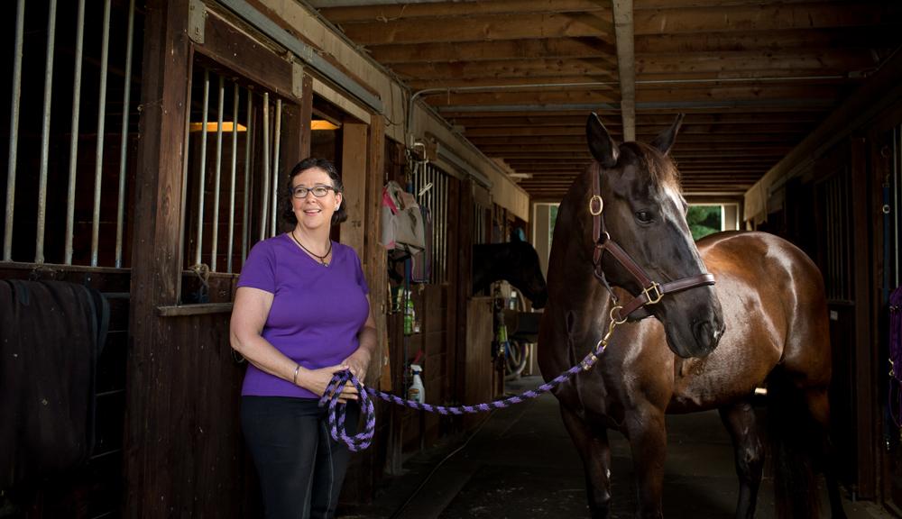 Bettyann holding horse reigns