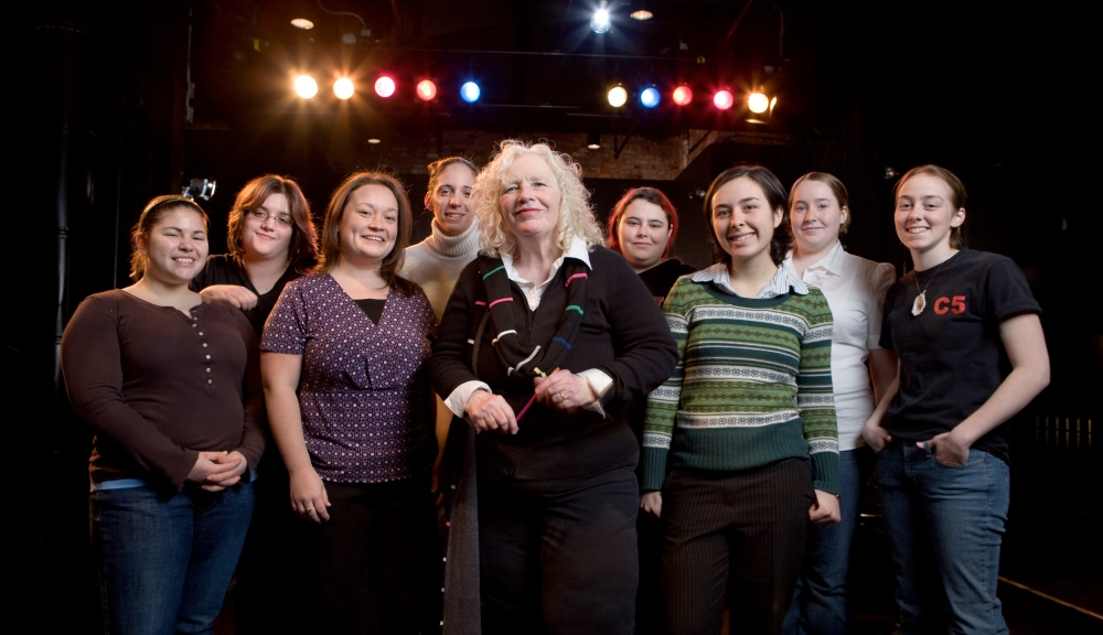 Susan Vick in 2008 in the Little Theatre, WPI's first dedicated theatre venue, surrounded by undergraduate theatre enthusiasts.