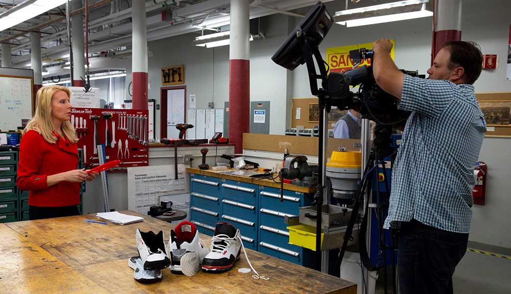 A news station and crew set up before covering the work of WPI students on their latest sports shoe designed to reduce ACL and other ankle and knee injuries.