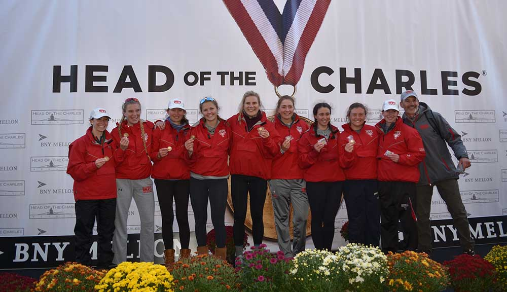 The Women's Rowing team smiles with their medals after placing during this year's Head of the Charles competition.