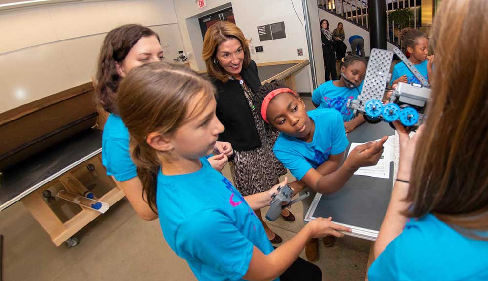 Students participate in STEM Week while Lieutenant Governor Karyn Polito looks on.