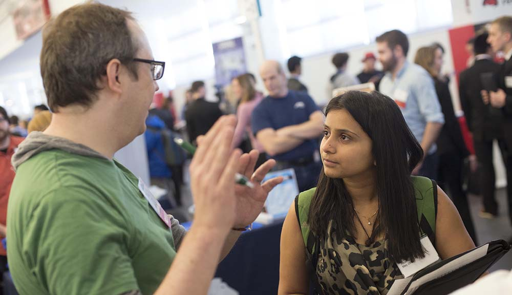 A student talks with an employer during one of WPI's biannual career fairs held in the Sports & Recreation Center.