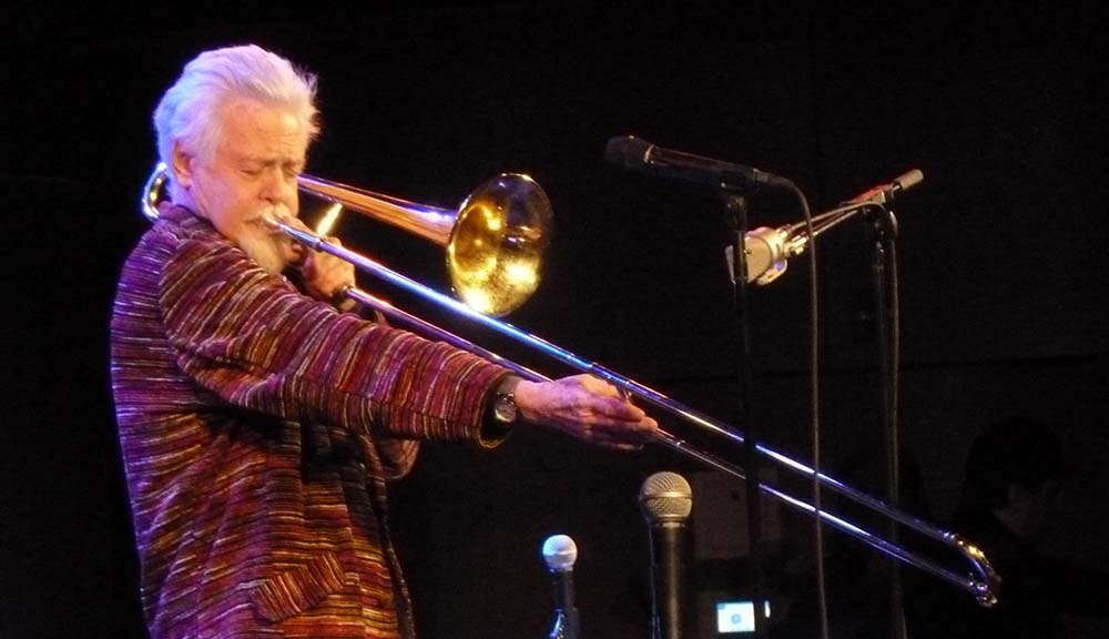 Roswell Rudd performs onstage.
