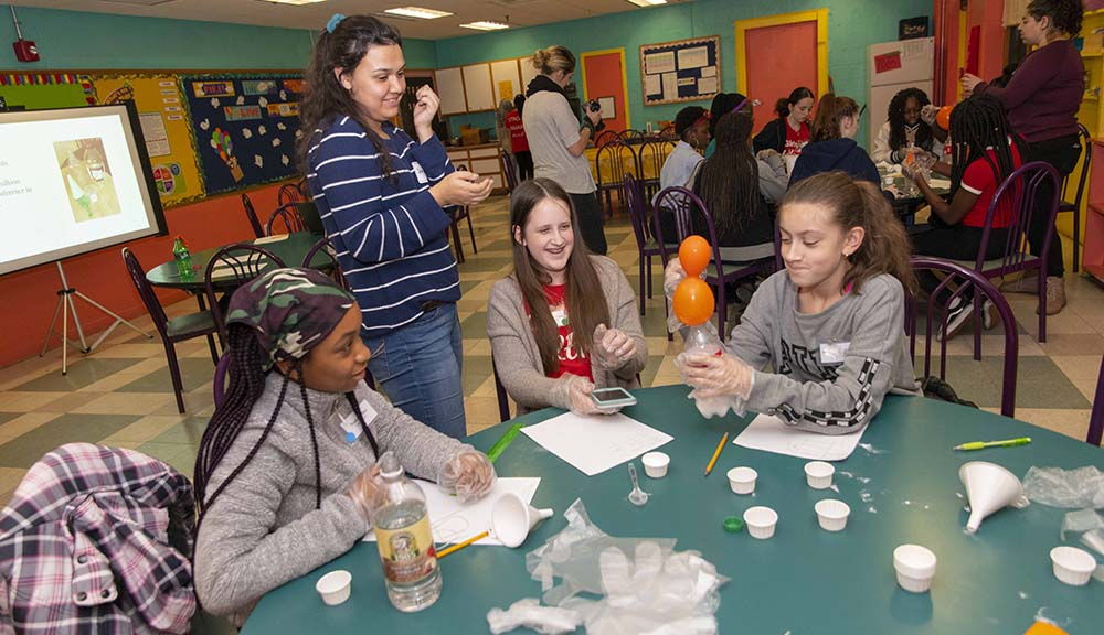 Students participate in a spooky science experiment at Girls, Inc.