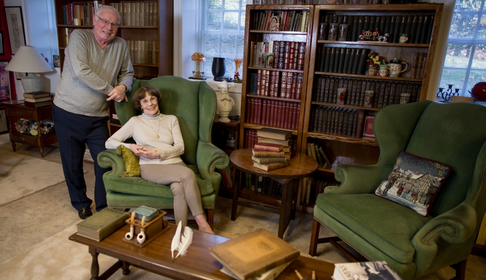 Daniel and Alice Ryan with parts of their collection on Charles Dickens, which will come to WPI in an extraordinary act of generosity