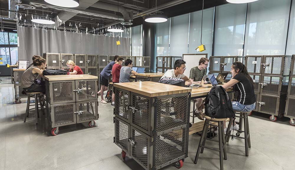 WPI students using tools in makerspace