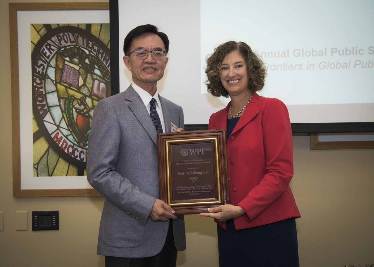 resident Laurie Leshin presents the Howard W. Emmons Distinguished Lecture Award to Professor Weicheng Fan of Tsinghua University