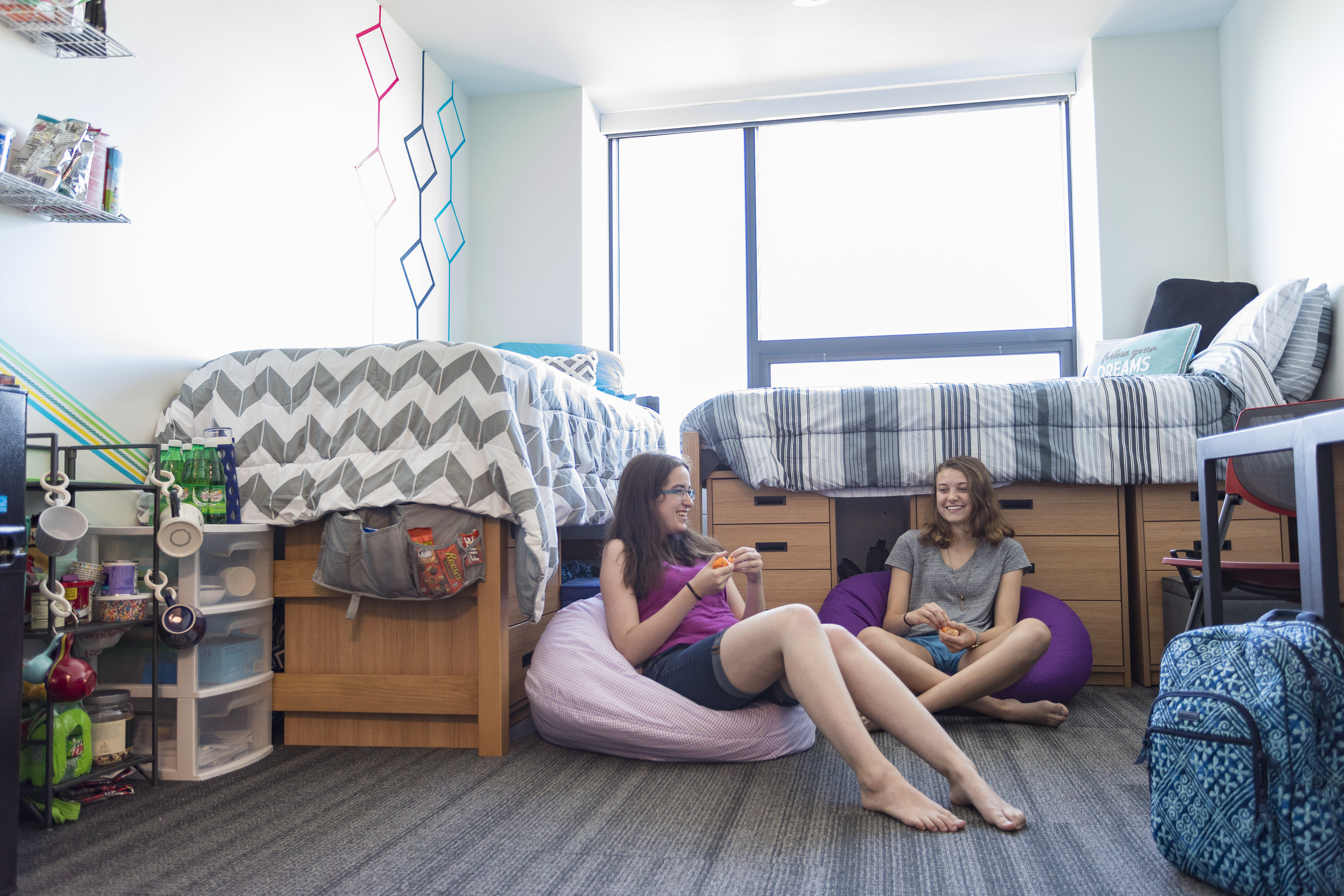Students sitting on floor in bean bag chairs.