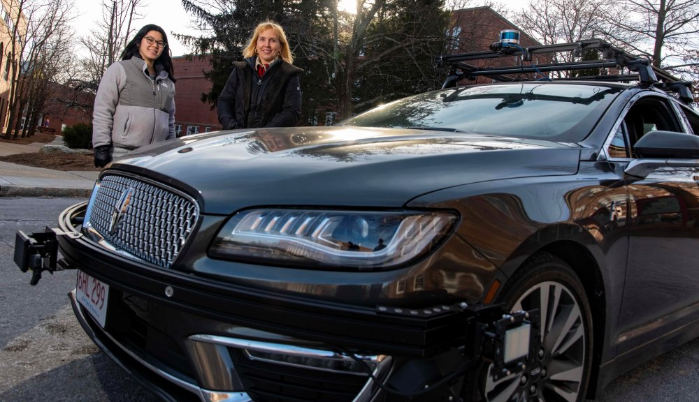 Elke Rundensteiner, right, and PhD student Allison Rozet with an autonomous vehicle testbed used for research at WPI. The event stream analytics tools they are developing could make driverless cars safer by analyzing data streaming from vehicles in real t