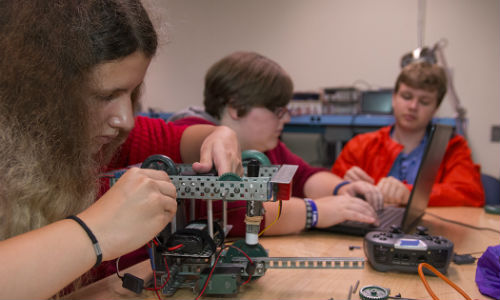 Students playing with robots.