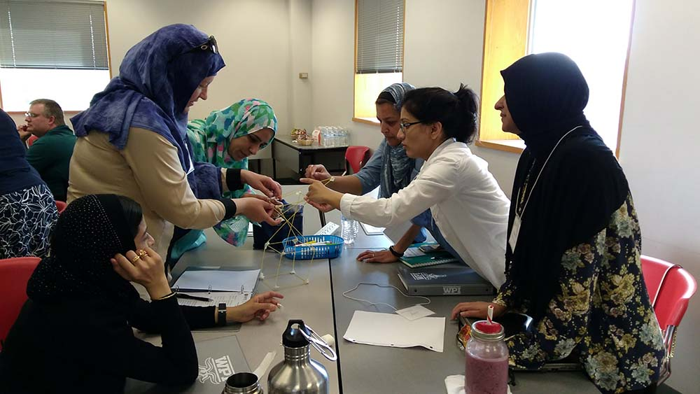 Strategic STEM participants work together on a hands-on project.