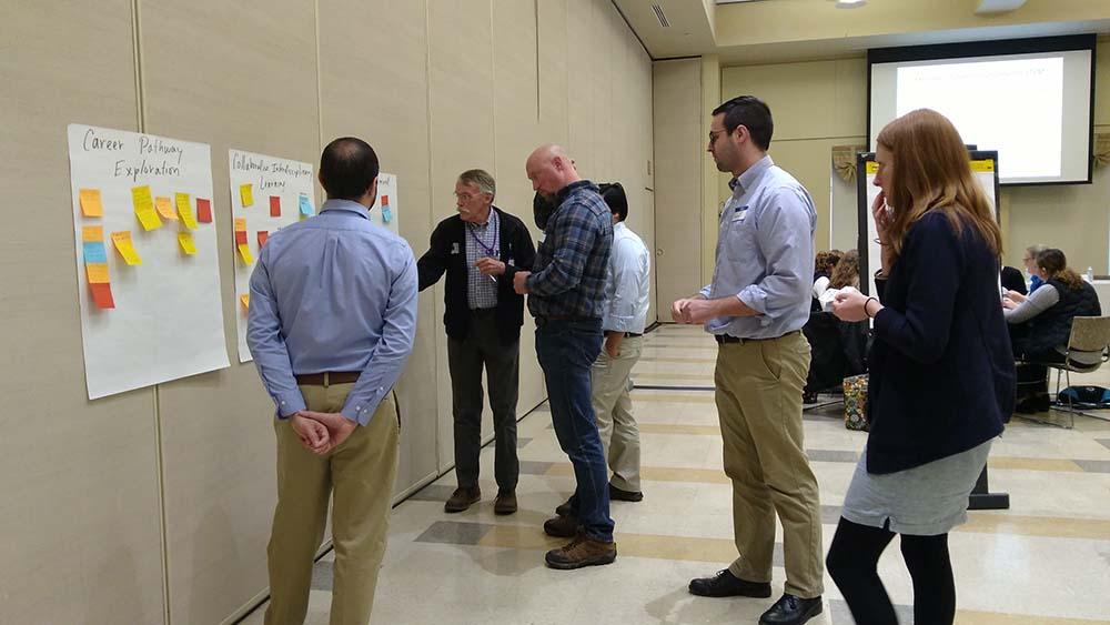 Strategic STEM participants collaborate on a team-building activity.