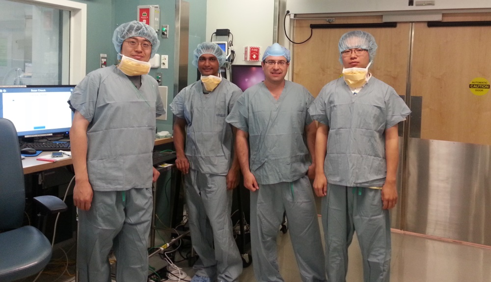 Gregory Fischer, second from right, with PhD candidates, from left, Weijian Shang, Nirav Patel, and Gang Li, at Brigham and Woman's Hospital, where a surgical robotic system he developed for prostate biopsies was involved in a clinical trial