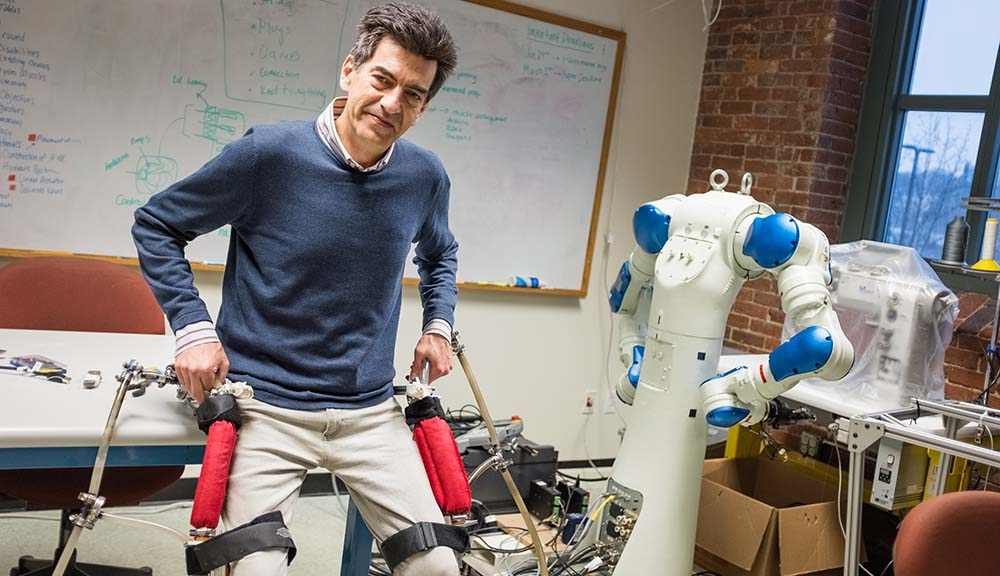 WPI researcher with exoskeleton