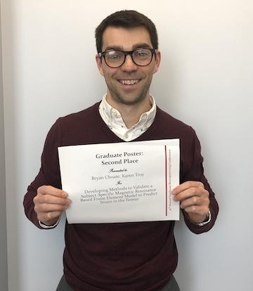 Bryan Choate with Award certificate