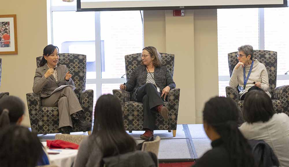 Three panelists in conversation at the Women in Data Science Conference.