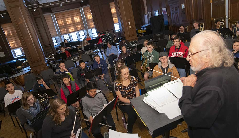 Doug Weeks conducts several students from Carlisle Middle School.
