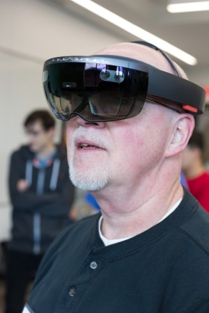 Man wearing virtual reality goggles alt