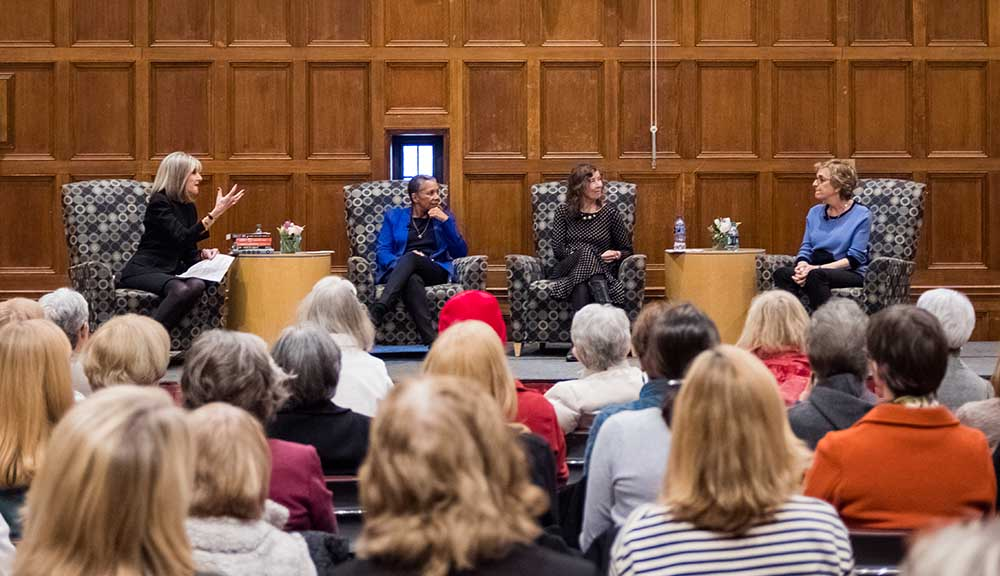 The panel during the women's writers event addresses a full crowd.