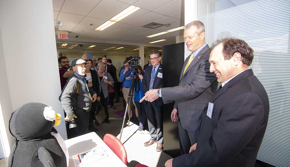 Charlie Baker visits PracticePoint and observes the PABI robot penguin.