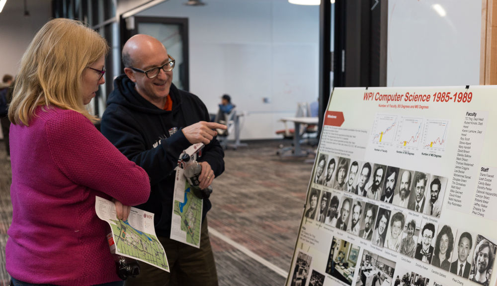 Attendees of the 50th anniversary of the Department of Computer Science look back on the history of the department in poster form.