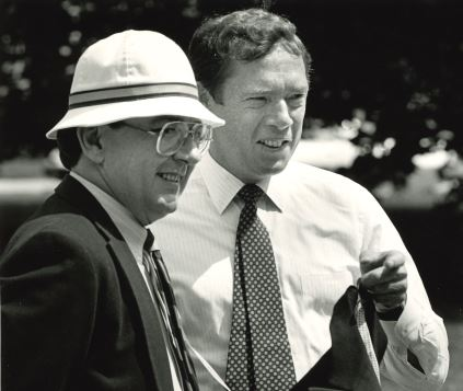 Allaire, right, has a conversation with an unidentified alumnus outdoors alt