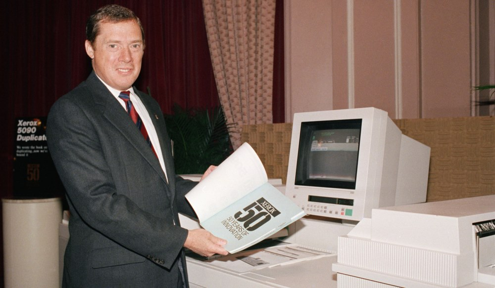 Paul Allaire in 1988 with a large copier with a computer monitor