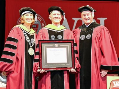 President Leshin, Kevin O'Sullivan, and Jack Mollen. O'Sullivan holds his honorary degree. alt