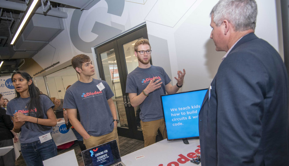 From left, Nisha Goel '22, Luke Trujillo '21, and Emmett McCann '21 of the Diodeck team chat about their e-Learning platform project with Bill Desmarais.