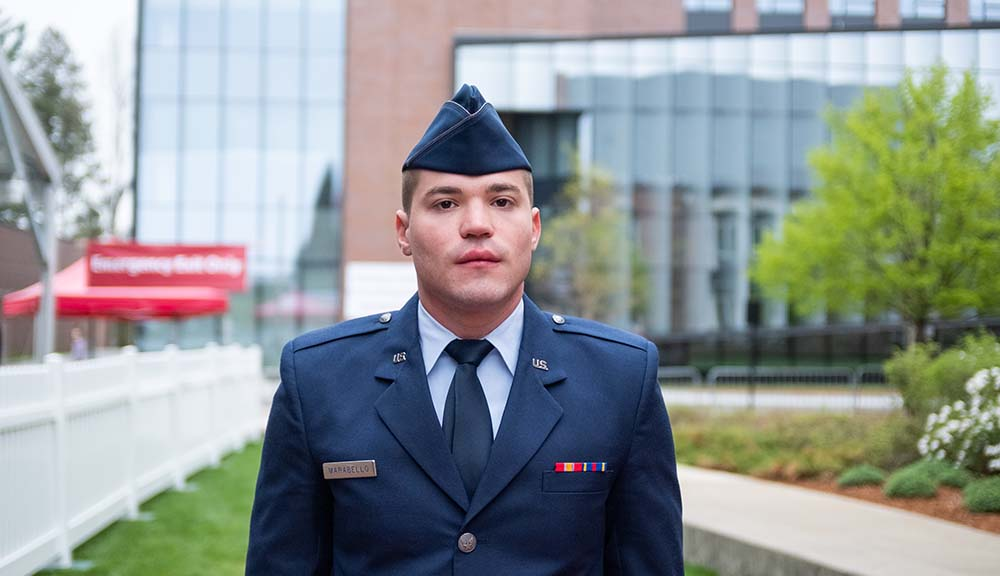 Jack Marabello, wearing his Air Force uniform, stands in front of the Foisie Innovation Studio before the ROTC Commissioning Ceremony.
