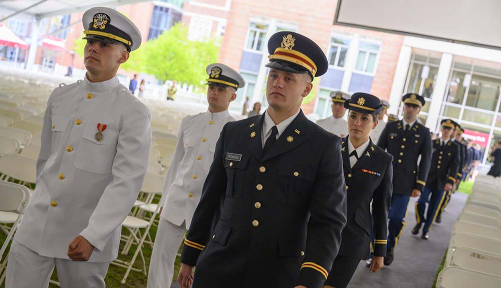 ROTC cadets march down to the Commencement stage on the Quad.