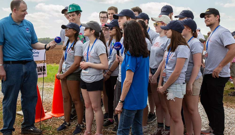 Group of WPI students being interviewed at NASA Rocket event