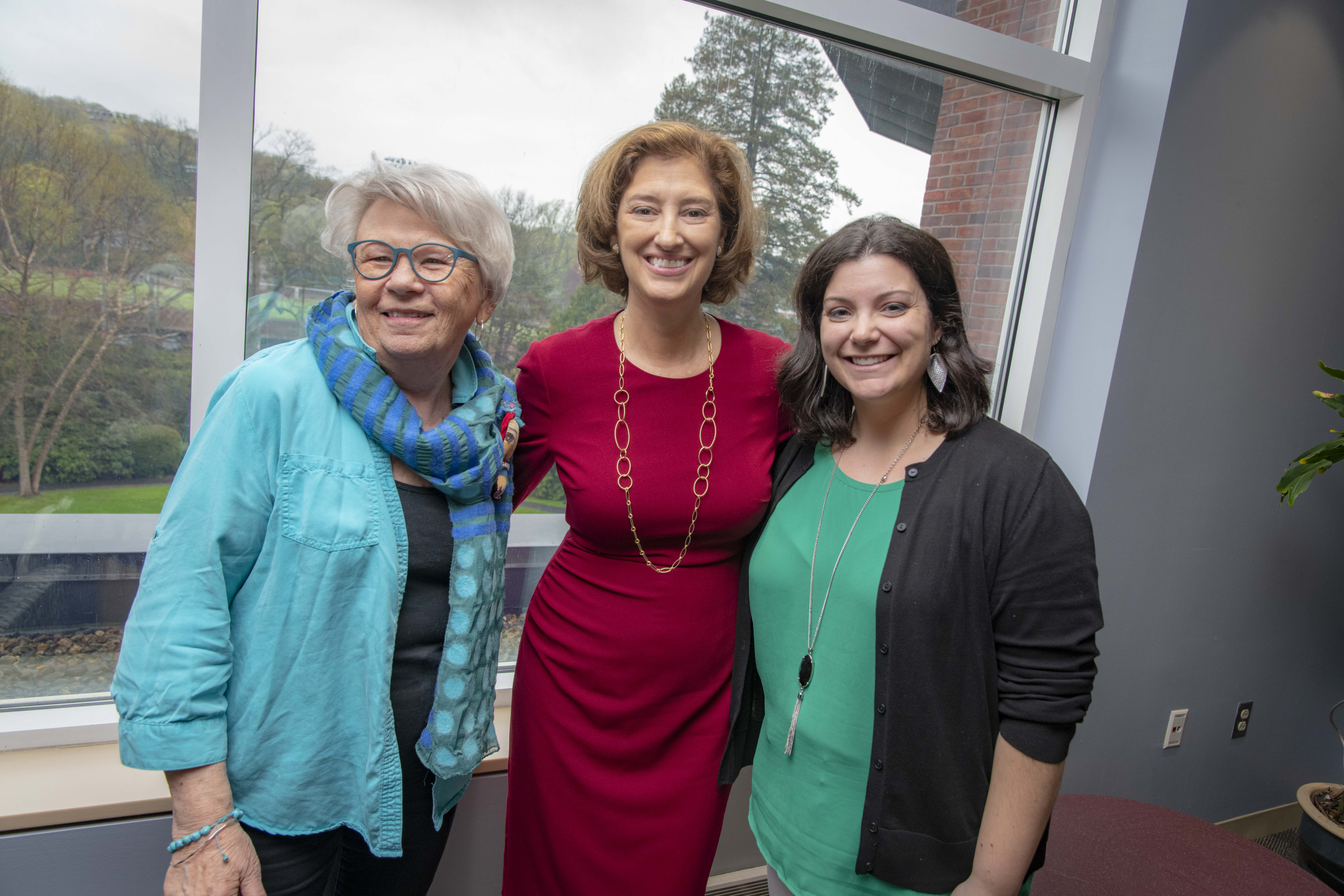 Peggy Isaacson, Laurie Leshin, and Laura Rosen smile together following the Town Hall meeting.