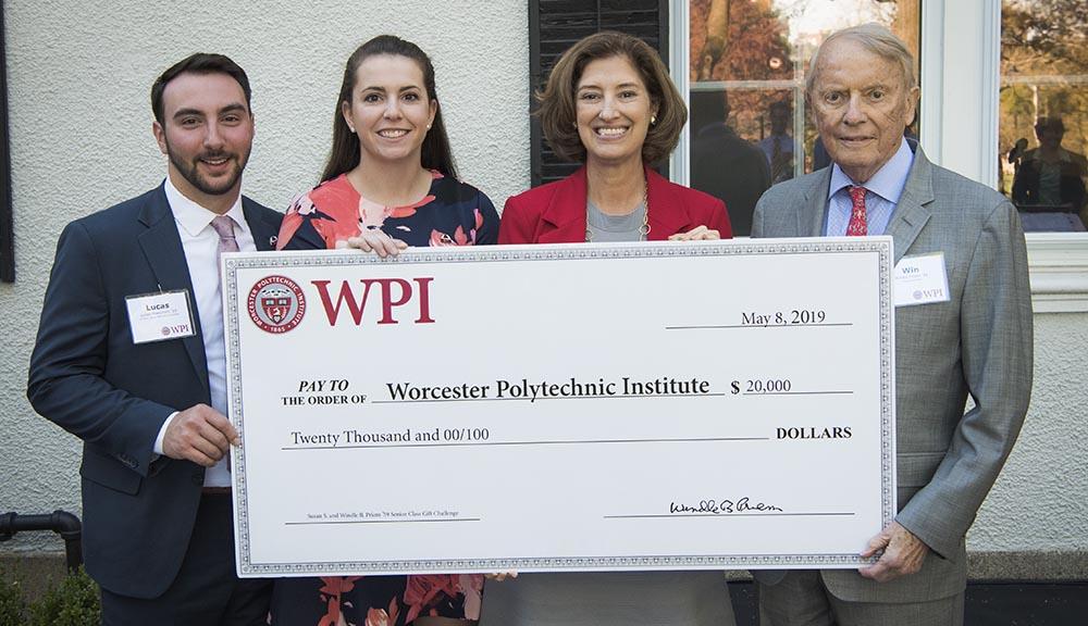 WPI trustee presenting check