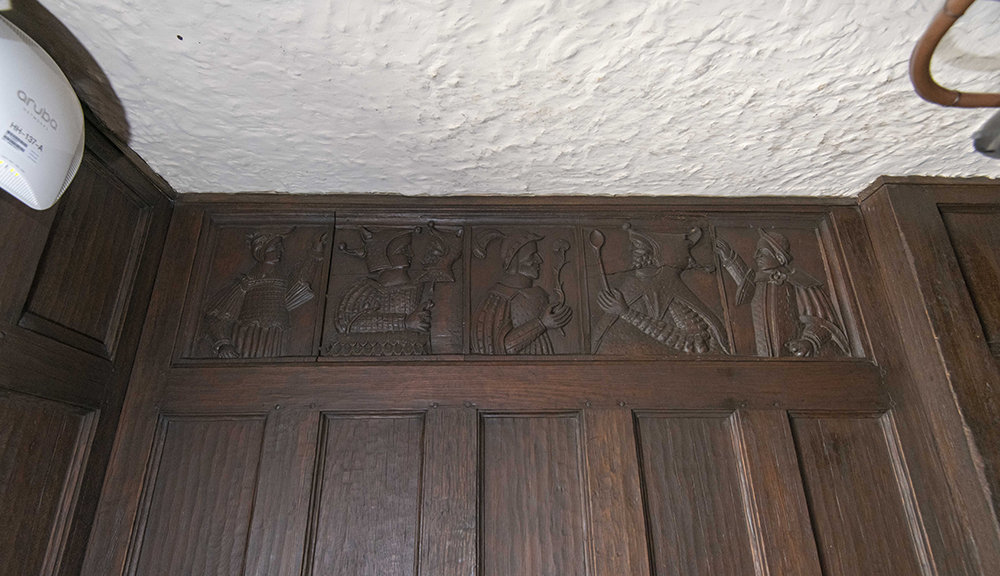 Wood carvings on the wall in Higgins House