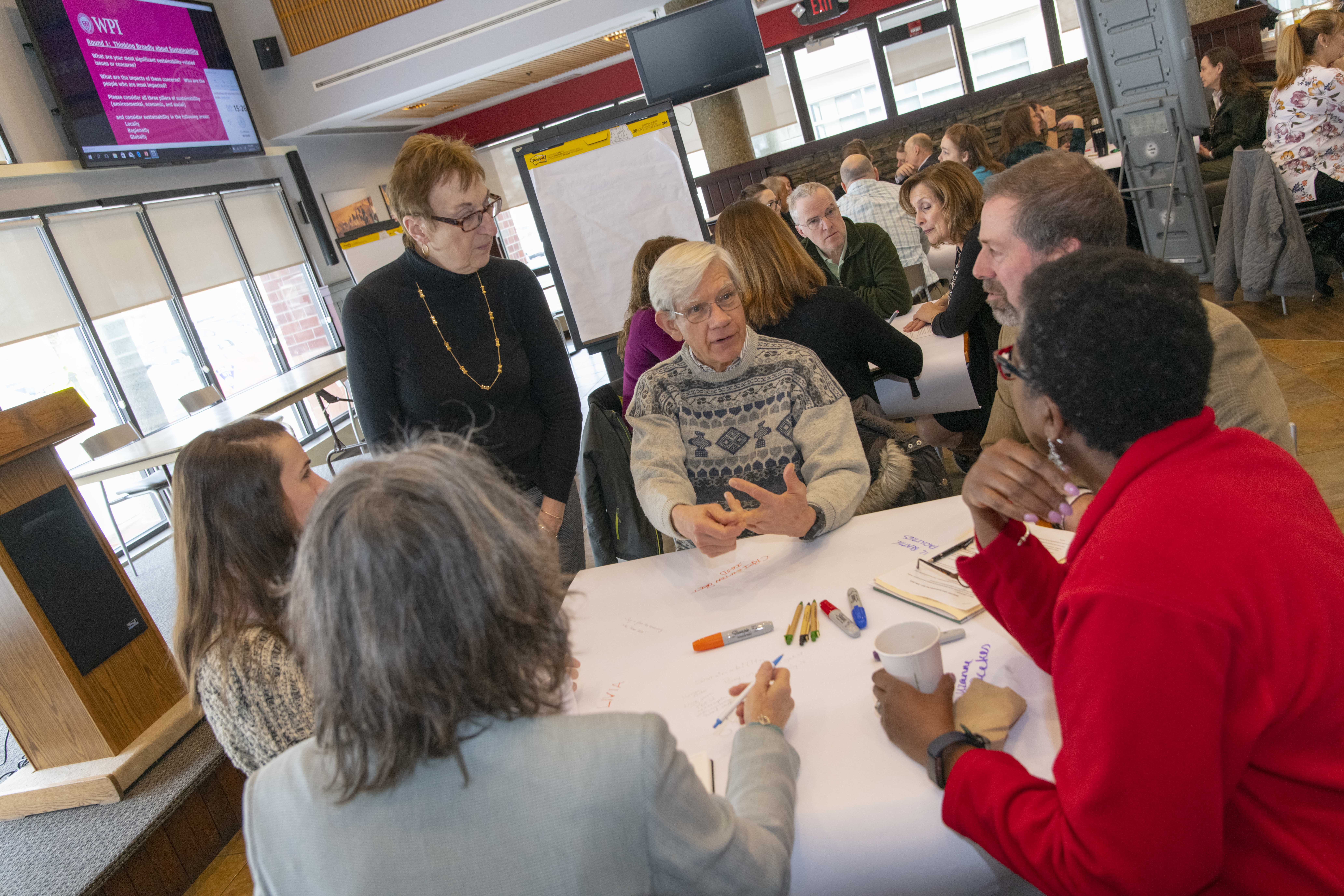 sustainability plan meeting of several people at a table