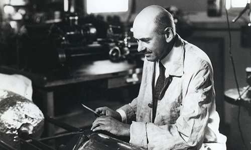Robert Goddard working on a rocket chamber
