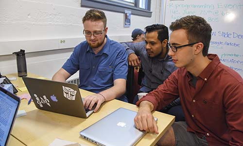 Students working together in a computer lab.
