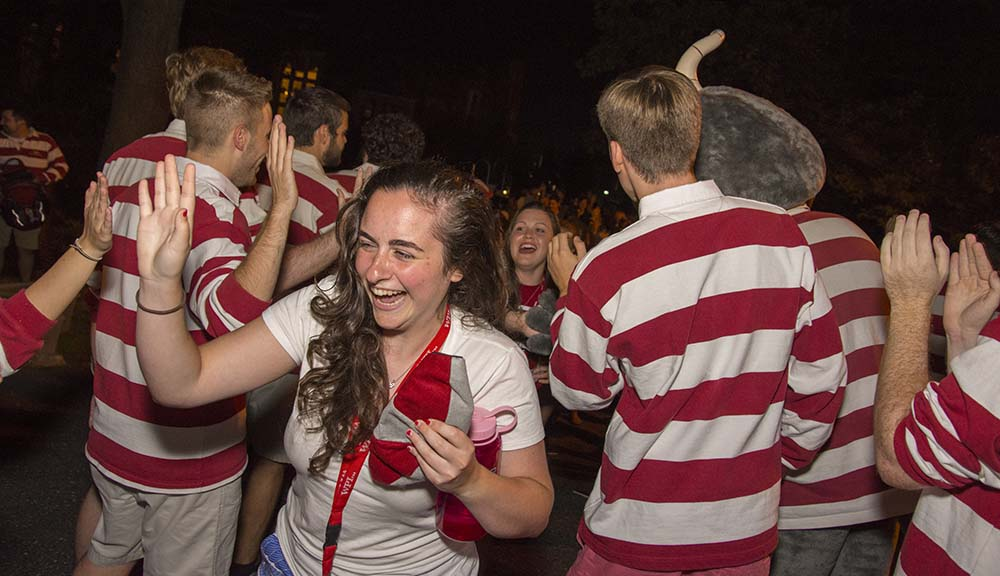 Students dressed in white and red striped shirt crossing Earle Bridge