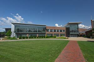 A photo of the exterior of the Sports & Recreation Center as well as part of the Quad.
