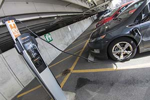 Cars are parked at one of the electric vehicle charging stations in the Park Ave garage.