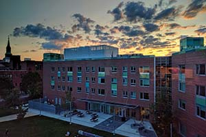 An aerial photo of Faraday Hall at sunset.