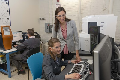Cote (left) is working with Kyle Tsaknopoulos, a postdoctoral fellow, on the research. alt