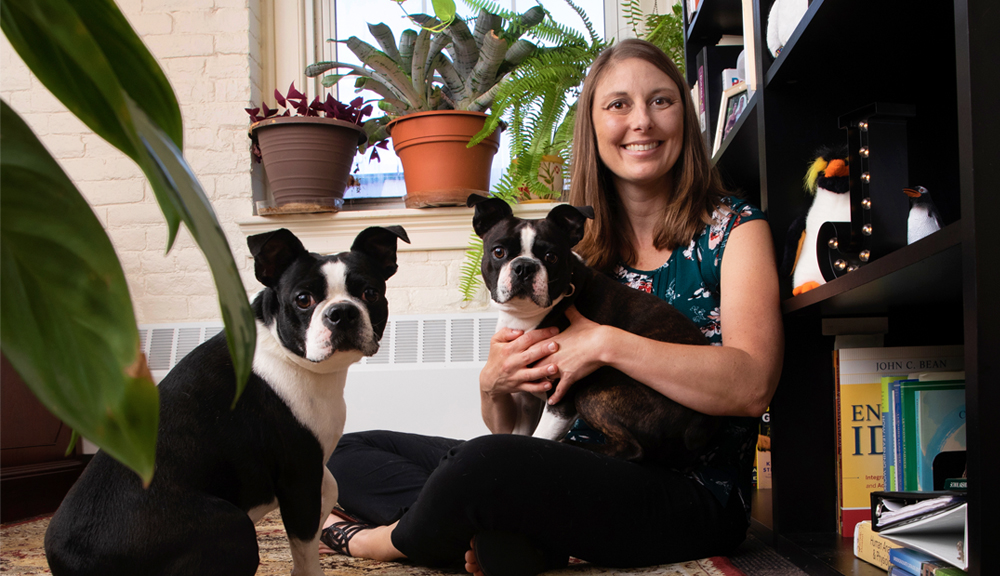 Professor Skorinko sitting in her office with her dogs