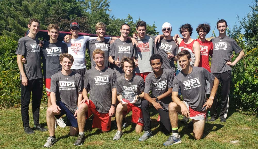 The men's cross country team gathers outside for a photo after a recent tournament win.