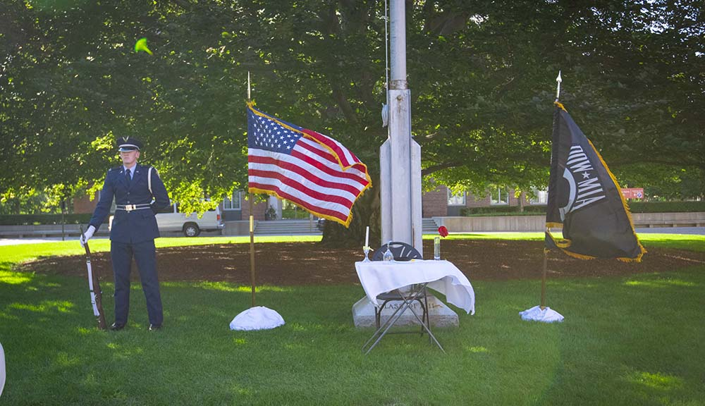 A ROTC cadet stands guard in front of the beech tree during POW/MIA Remembrance Day.