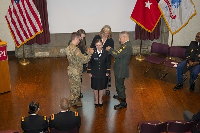 Rachel Murphy being  pinned by her brother, Rutger, left and father, Robert. alt