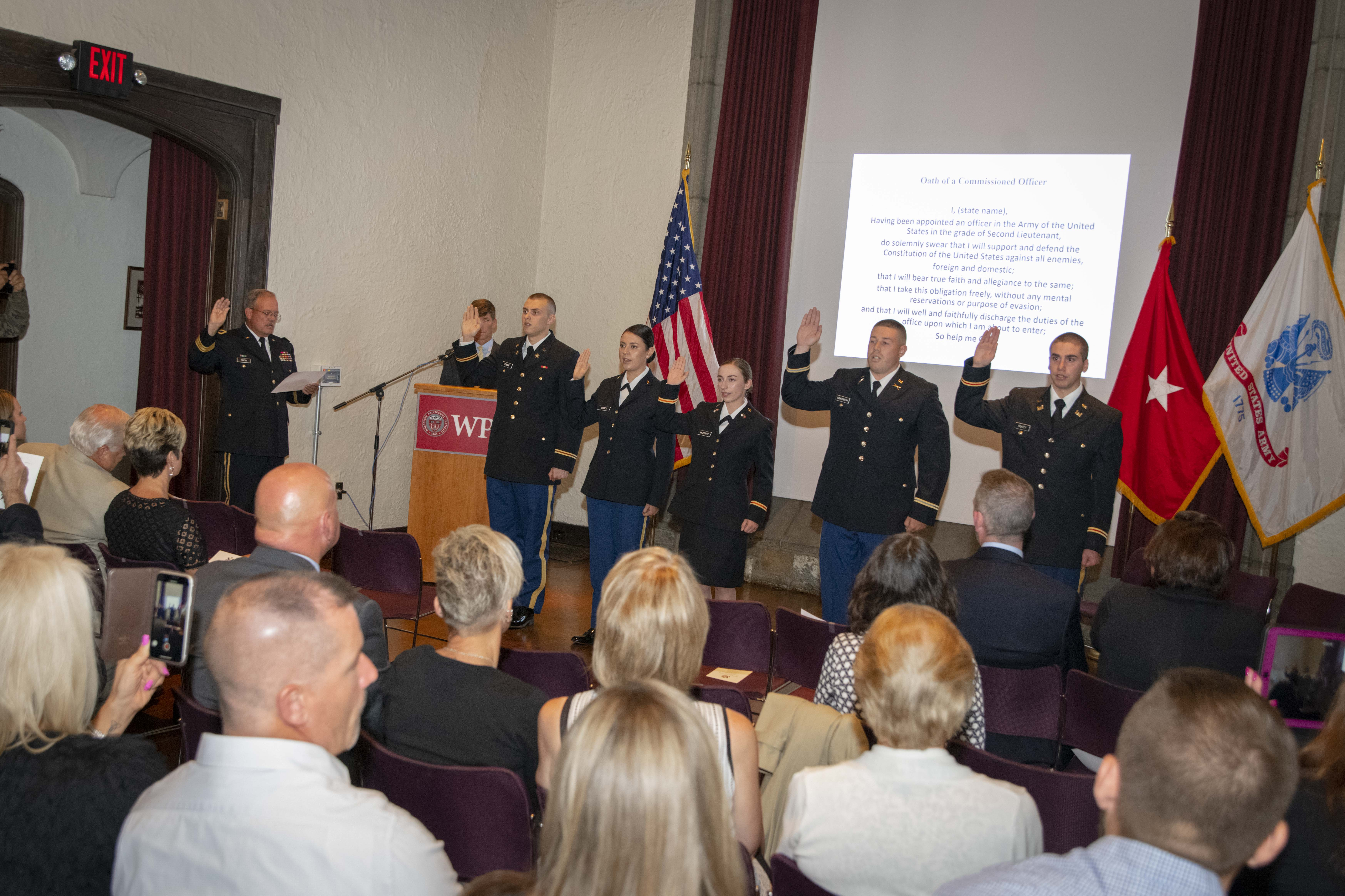 Newly commissioned ROTC cadets in Higgins House during their commissioning ceremony.
